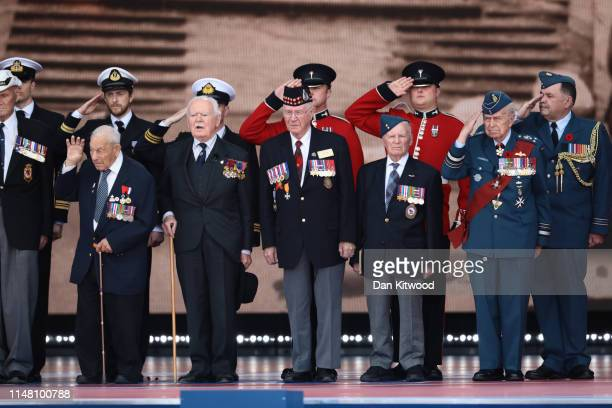 Veterans salute from the stage as they attend the DDay Commemorations on June 5 2019 in Portsmouth England The political heads of 16 countries...