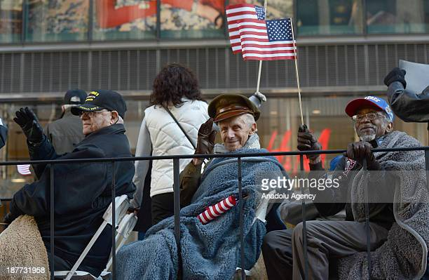 Veterans salute participants during the annual Veterans Day parade to honor US military and the US Armed Services Special Forces at 5th Avenue on...