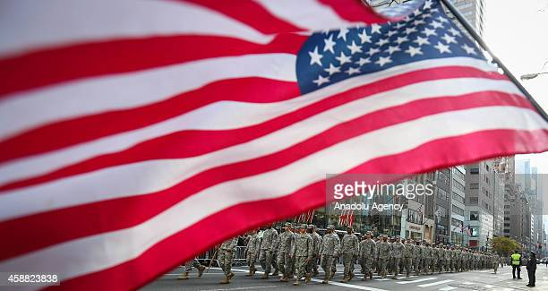 Veterans soldiers their families and others march in the annual the Veteran's Day Parade along Fifth Avenue on November 11 2014 in New York City...