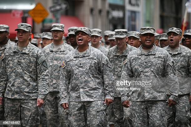 Veterans soldiers their families and others march in the annual the Veteran's Day Parade along Manhattan's Fifth Avenue in New York City United...