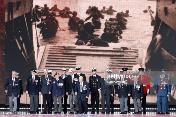Veterans stand on stage during the DDay Commemorations on June 5 2019 in Portsmouth England The political heads of 16 countries involved in World War...