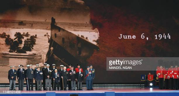 Veterans take part in an event to commemorate the 75th anniversary of the D-Day landings, in Portsmouth, southern England, on June 5, 2019. - US...