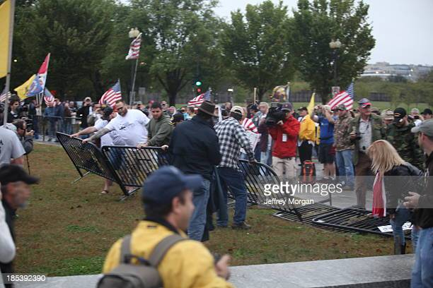 Veterans tear down barricades surrounding WWII Memorial during government shutdown protest 10-13-13 Million Vet March WWII Memorial Washington D.C....