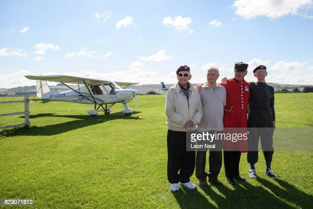 Veterans Ted Pieri Dick Carpenter Mike Smith and Fred Glover pose for photographs ahead of their skydive at the Old Sarum airfield on August 10 2017...