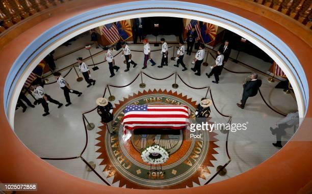 Veterans walk past the casket of Sen. John McCain, R-Ariz. During a memorial service at the Arizona Capitol on August 29, 2018 in Phoenix, Arizona....