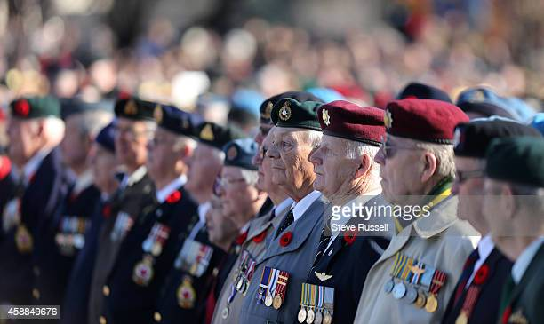OTTAWA ON NOVEMBER 11 Veterans watch the ceremony The nation's capital observes Remembrance Day at the National War Memorial in the in Ottawa...