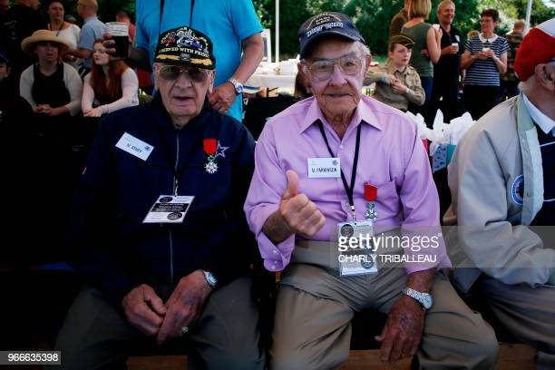 US WWII veterans Wesley Athey and Franck Parkinson attend a landing demonstration in SainteMereEglise northwestern France on June 3 2018 during the...