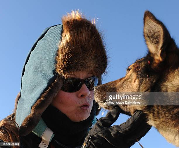 Veterinarian Samantha Yeltatzie visits Paul Gebhardt's sled dog Cocoa as she examines his team at the Nikolai Alaska checkpoint during the Iditarod...