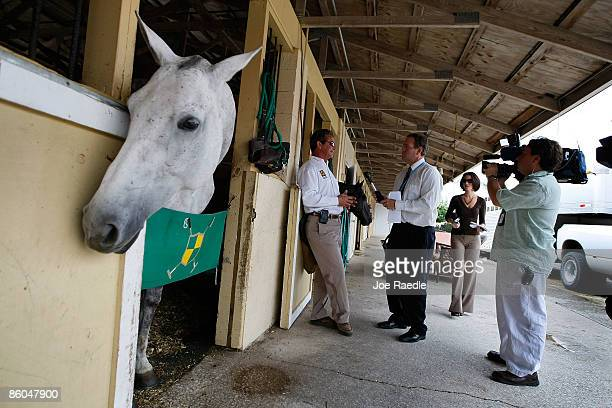 Veterinarian Scott Swerdlin talks to reporters about having to respond to the International Polo Club where the US Open polo tournament was being...