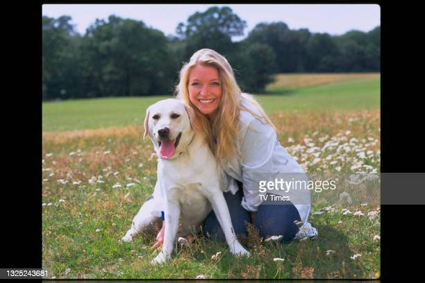 Veterinarian Trude Mostue, known for her role in BBC documentary series Vets In Practice, photographed outdoors with a Labrador Retriever, circa 1997.