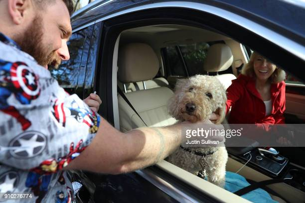 Veternarian technician Justin Jones preapres to give a dog named Sadie a canine influenza immunization at Los Gatos Dog and Cat Hospital on January...