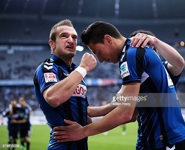 Veton Berisha of SpVgg Greuther Furth congratulates Robert Zulj after he scored the first goal during 2 Bundesliga match between 1860 Muenchen and...