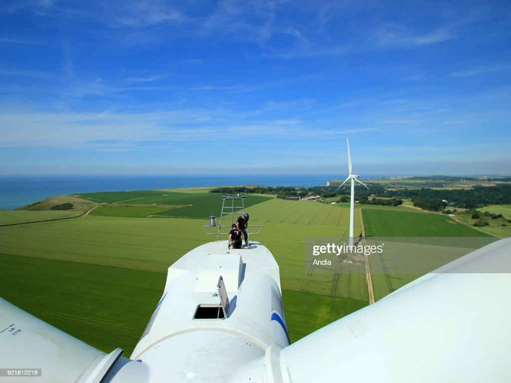 Veulettes-sur-Mer (Normandy, northern France), on : wind turbine inspection, two technicians on the roof.