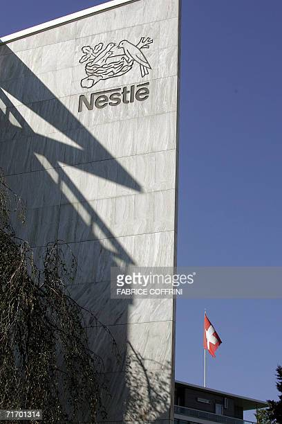 A Swiss flag and the logo of the Nestle are seen on the roof of the company's Headquaters 23 August 2006 in Vevey Switzerland Nestle the Swiss food...