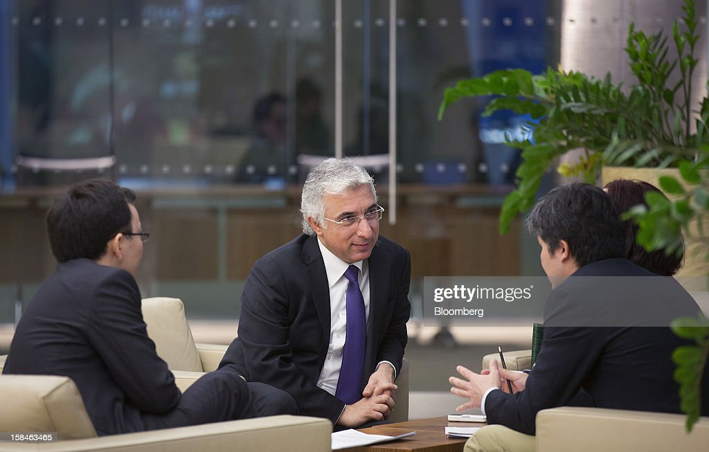 Veysel Aral, chief executive officer of Kcell, a unit of TeliaSonera AB, center, attends the launch of the company's initial public offering (IPO) at the London Stock Exchange in London, U.K., on Monday, Dec. 17, 2012. Kcell, which has 11.6 million subscribers, is the largest operator in Kazakhstan with a subscriber market share of about 48 percent and a revenue market share of 57 percent, Aral said. Photographer: Simon Dawson/Bloomberg via Getty Images