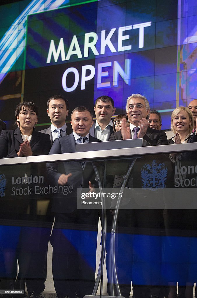 Veysel Aral, chief executive officer of Kcell, a unit of TeliaSonera AB, second right, applauds during the launch of the company's initial public offering (IPO) at the London Stock Exchange in London, U.K., on Monday, Dec. 17, 2012. Kcell, which has 11.6 million subscribers, is the largest operator in Kazakhstan with a subscriber market share of about 48 percent and a revenue market share of 57 percent, Aral said. Photographer: Simon Dawson/Bloomberg via Getty Images
