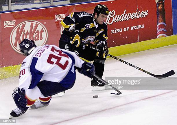 Vezio Sacratini of the Knights steels the puck from the Bees defence during the Ice Hockey Superleague match between London Knights and Bracknell...