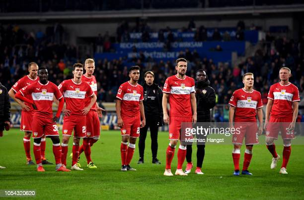 VfB Stuttgart players look on infront of their fans after their defeat in the Bundesliga match between TSG 1899 Hoffenheim and VfB Stuttgart at...