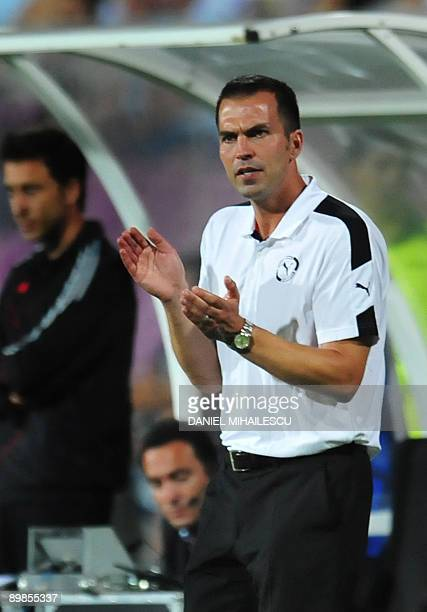 VfB Stuttgart's coach Markus Babbel applauds at the end of the match against FC Timisoara during playoff football match of UEFA Champions League in...