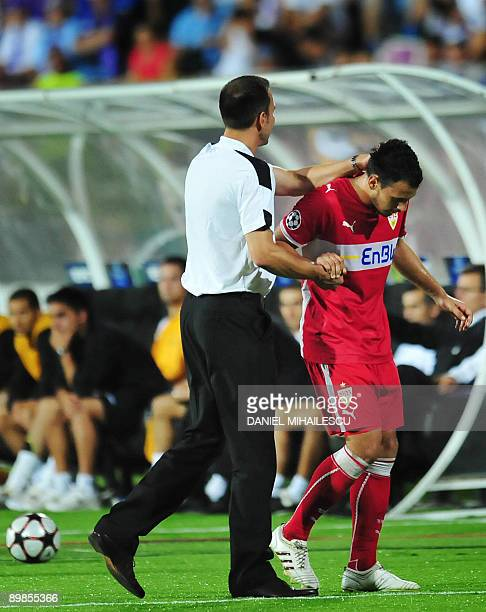 VfB Stuttgart's coach Markus Babbel congratulates Timo Gebhart during the match against FC Timisoara during playoff football match of UEFA Champions...