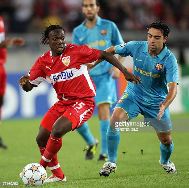 VfB Stuttgart's Ivorian defender Arthur Boka vies for the ball against FC Barcelona's midfielder Xavi Hernandez during their Champions League group E...
