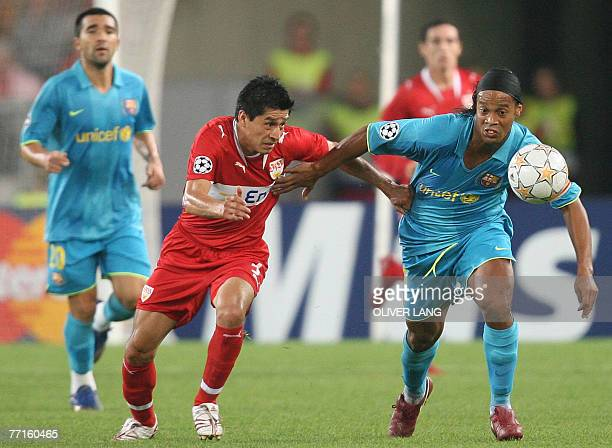 VfB Stuttgart's Mexican defender Ricardo Osorio vies for the ball against FC Barcelona's Brazilian striker Ronaldinho during the Stuttgart vs...
