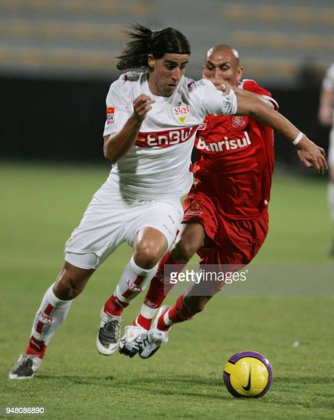 VfB Stuttgart's midfielder Sami Khedira fights for the ball with Pablo Guinazu of Brazil's Internacional de Porto Alegre during their match at the...