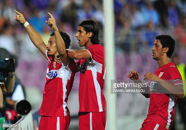 VfB Stuttgart's Timo Gebhart celebrates after he scored 10 against FC Timisoara's togheter with teammates Sami Khedira and Ciprian Marica during...
