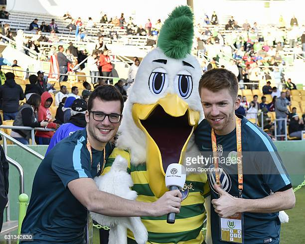 Vfl media staff pose with Tampa Bay Rowdies mascot Pelican Pete prior to the start of a Florida Cup soccer game between the Tampa Bay Rowdies and Vfl...