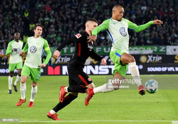 VfL Wolfsburg and Eintracht Frankfurt face off in a Bundesliga match in Wolfsburg Germany 20 January 2018 Wolfsburg's Marcel Tisserand and...