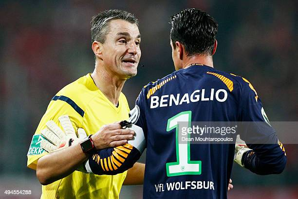 VfL Wolfsburg captian Diego Benaglio speaks to the match referee Knut Kircher during the DFB Cup match between VfL Wolfsburg and FC Bayern Muenchen...