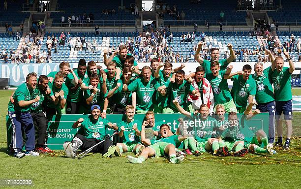 VfL Wolfsburg celebrate with the trophy after winning the A Juniors Bundesliga final match between FC Hansa Rostock and VfL Wolfsburg at DKBArena on...