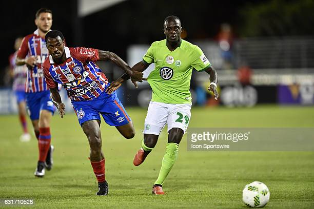 Vfl Wolfsburg midfielder Amara Conde dribbles away from Bahia midfielder Rene Junior during the first half of the Florida Cup game between VfL...