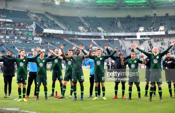 VfL Wolfsburg players celebrate with fans following the Bundesliga match between Borussia Moenchengladbach and VfL Wolfsburg at BorussiaPark on...