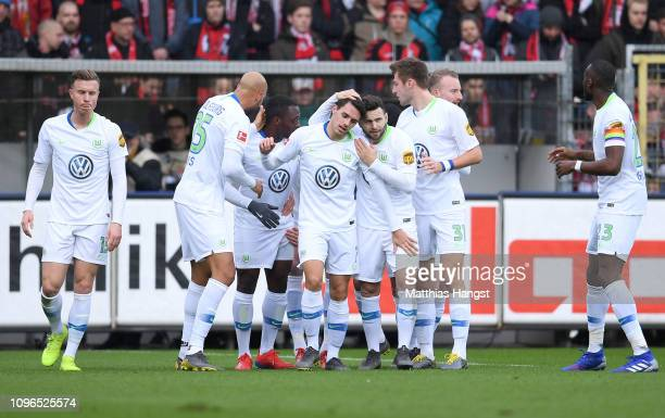 Vfl Wolfsburg players celebrates after their team's first goal during the Bundesliga match between SportClub Freiburg and VfL Wolfsburg at...
