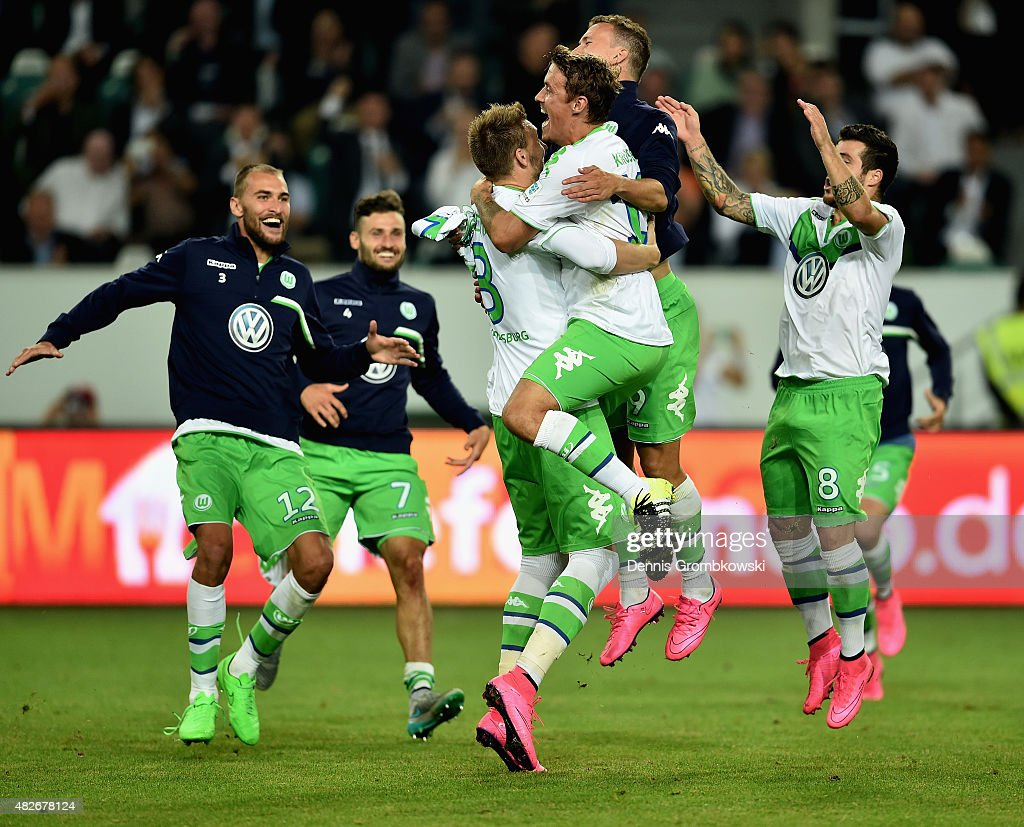 VfL Wolfsburg team celebrates after the DFL Supercup 2015 match between VfL Wolfsburg and FC Bayern Muenchen at Volkswagen Arena on August 1, 2015 in Wolfsburg, Germany.