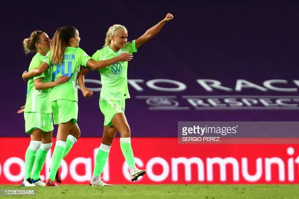 VfL Wolfsburg's Danish forward Pernille Harder celebrates with teammates their team's victory at the end of the UEFA Women's Champions League...