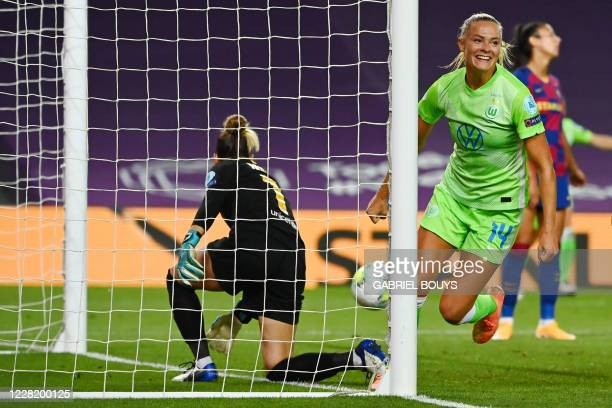 VfL Wolfsburg's Swedish midfielder Fridolina Rolfo celebrates her goal during the UEFA Women's Champions League semifinal football match between VFL...