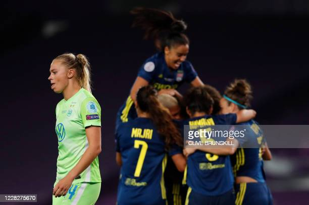 VfL Wolfsburg's Swedish midfielder Fridolina Rolfo reacts as Lyon's players celebrate their third goal during the UEFA Women's Champions League final...