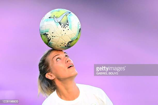 VfL Wolfsburg's Swiss midfielder Lara Dickenmann warms up before the UEFA Women's Champions League semi-final football match between VFL Wolfsburg...