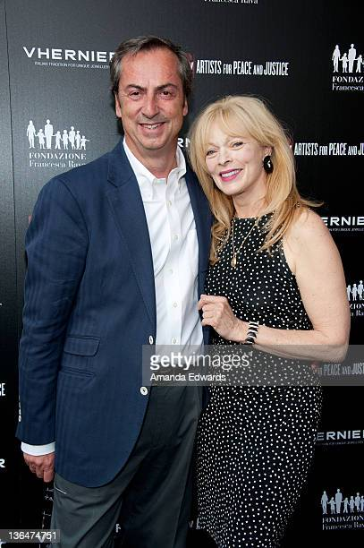 Vhernier Jewels President Carlo Traglio and actress Frances Fisher arrive at the Artists for Peace and Justice A Ring to Educate a Child in Haiti...