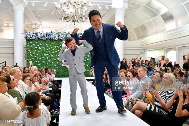 Vhito DeCapria and Masahiro Tanaka walk the runway as Runway Heroes Walk With The Yankees At Kleinfeld on June 18, 2019 in New York City.