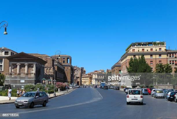 Via del Teatro di Marcello and Temple of Portunus in Forum Boarium, Piazza Bocca della Verita, Rome, Italy.