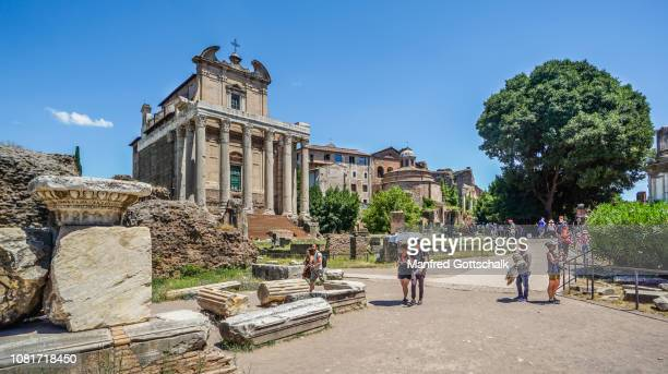 via sacra at the roman forum, the ancient city of rome, in the background the antonius and faustina temple which became the church of san lorenzo, rome, italy, june 28, 2018 - san stock pictures, royalty-free photos & images
