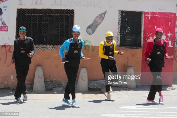 Via Vyndal members Kagiso Ngqulunga Bafana Binda Sandile Ngqulunga and Daniel Chaka show their dance moves outside the Thusong Youth Centre on...