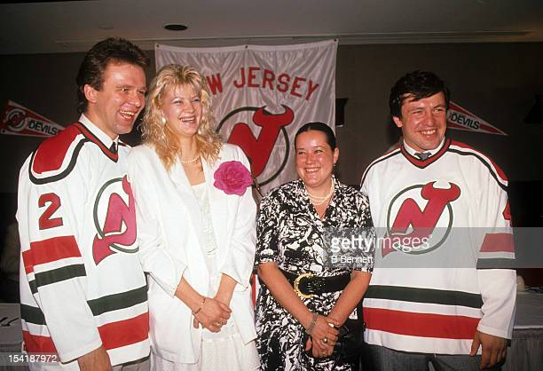 Viacheslav Fetisov and Sergei Starikov of the Soviet Union sign with the New Jersey Devils during a press conference on July 7 1989 at the Brendan...