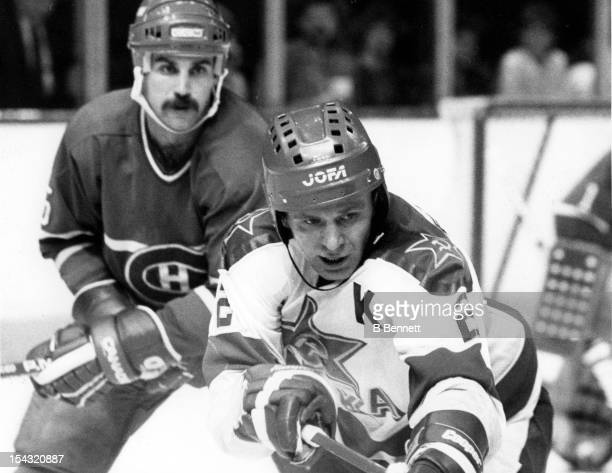 Viacheslav Fetisov of CSKA Moscow tries for the puck as Rick Green of the Montreal Canadiens defends on December 31, 1985 at the Montreal Forum in...