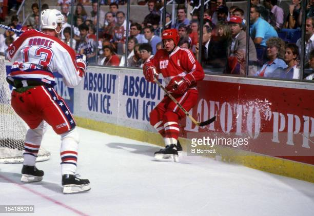 Viacheslav Fetisov of the Soviet Union passes the puck as Bob Brooke of the United Skates looks to check during the 1987 Canada Cup on September 4...