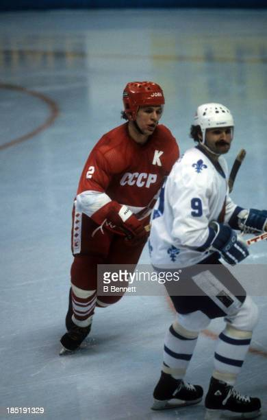 Viacheslav Fetisov of the USSR defends against Real Cloutier of the Quebec Nordiques during the 198283 Super Series on December 30 1982 at the Quebec...
