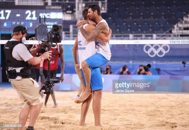 Viacheslav Krasilnikov and Oleg Stoyanovskiy of Team ROC react after defeating Team Qatar during the Men's Semifinal beach volleyball on day thirteen...